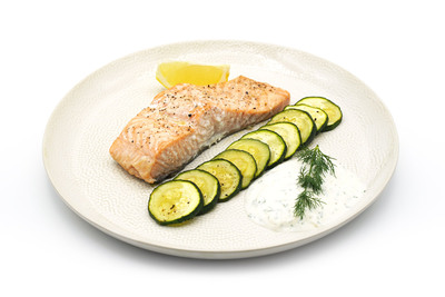 Oven-baked salmon with slices of zucchini and yoghurt dip is a great option for a light, filling dinner.